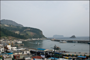 Jeodong Harbour in foreground with Buk Jeo Rock and Jukdo Island in the background to the Northeast