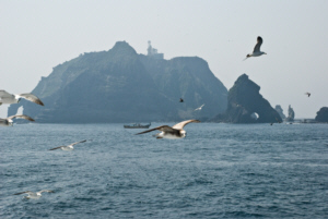Hole Rock, seagulls, a fishing boat and Dokdo's East Islet