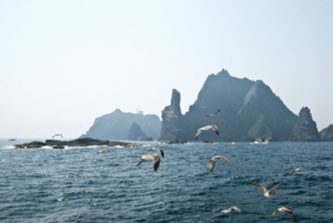 Dokdo's West Islet in foreground with Hole Rock and East Islet behind 독도 獨島 竹島 たけしま