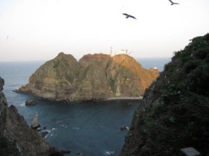 On top of Dokdo's West Islet looking at the East Islet (note beach below)